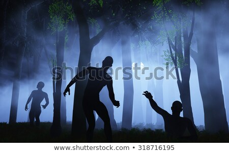 Walking dead in spooky foggy cemetery Stock photo © ankarb