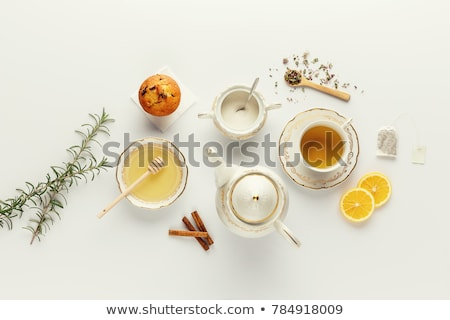 lavender cookies and cup of tea on white wooden background stock photo © vlad_star