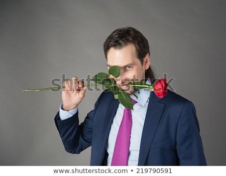 Jólöltözött fiatalember piros rózsa férfi rózsa virág Stock fotó © nickp37