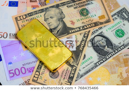 gold bullion and dollar bills  Stock photo © OleksandrO