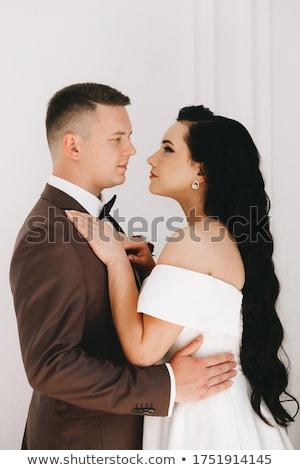 retrato · belo · beijando · casal · cama - foto stock © deandrobot