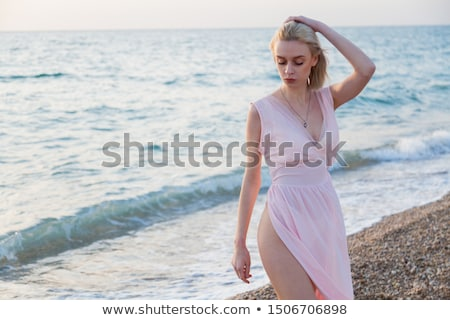 portrait of a pretty young woman lying on deckchair outdoors stock photo © deandrobot