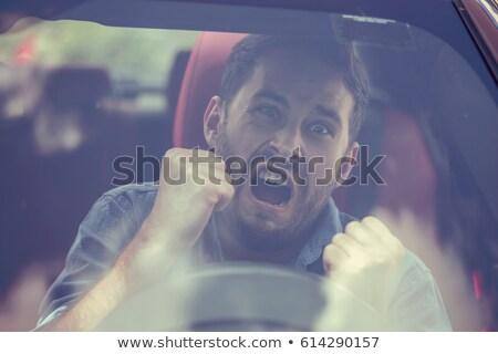 Urlando uomo auto faccia telefono occhiali Foto d'archivio © konradbak