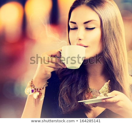 Close up portrait of woman drinking coffee Stock photo © deandrobot