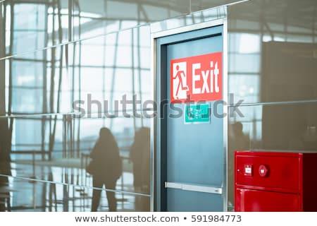 Repülőtér kijárat jelzés zöld bent modern nap Stock fotó © ldambies