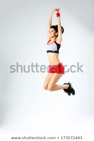 Vital and athletic girl jump Stock photo © alphaspirit