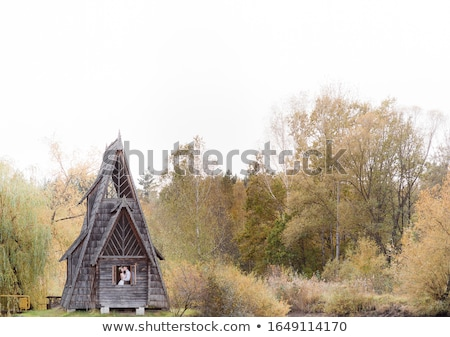 Photo of beautiful couple on nature in wooden hut Stock photo © tekso