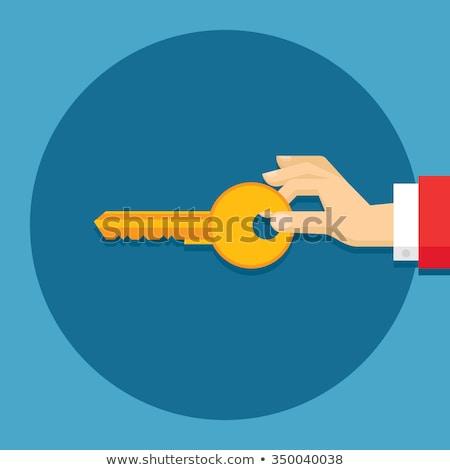 Door Key in Human Hand Flat Style Vector Stock photo © robuart