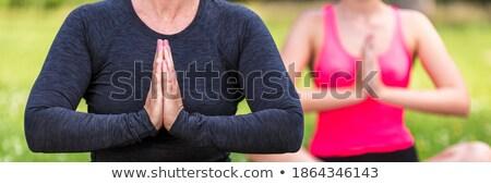 S'adapter anonyme fille noir yoga pants Photo stock © julenochek