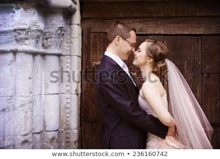 a wedding couple outside a chapel stock photo © is2