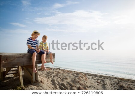 Woman and children on jetty Stock photo © IS2