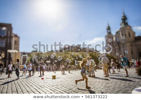 Tourists in city square Stock photo © IS2