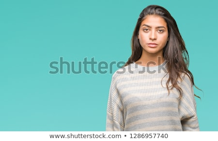 Ragazza guardando fotocamera seriamente ritratto sfondo bianco Foto d'archivio © IS2