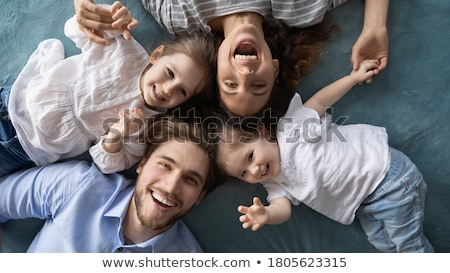 Photo from above of happy family mother and baby girl spending t Stock photo © deandrobot