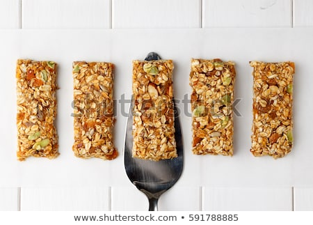 cereal bars and oats on wooden board stock photo © dash