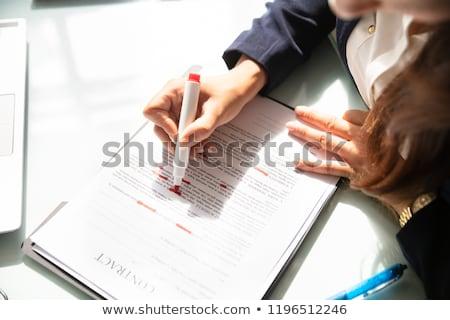 Businesswoman Marking Error In Contract Form Stock photo © AndreyPopov
