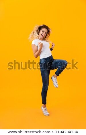 Full length photo of energetic blond woman in basic clothing smi Stock photo © deandrobot