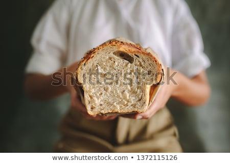Female baker holding fresh bread Stock photo © colematt
