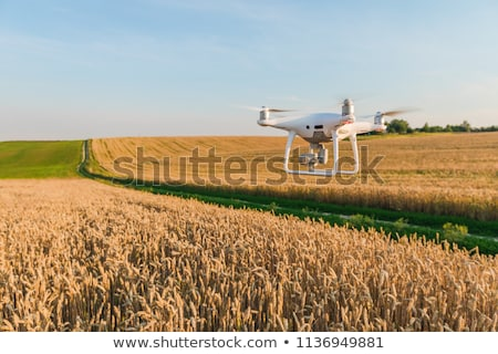 Flying drone in the sky Stock photo © boggy
