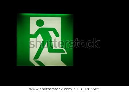 Emergencia señal de salida habitación espacio de la copia gris pared Foto stock © make