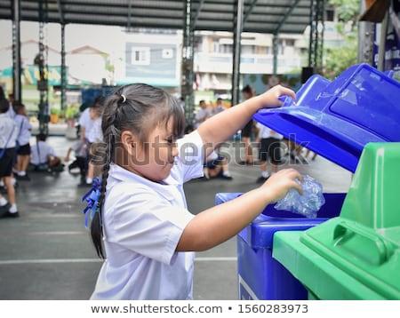 Girl throwing bottle in trashcan Stock photo © colematt