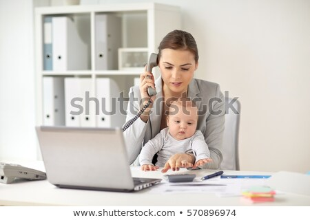 working mother counting on calculator and baby Stock photo © dolgachov