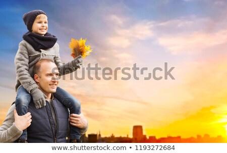 happy family over sunset in tallinn city in autumn stock photo © dolgachov