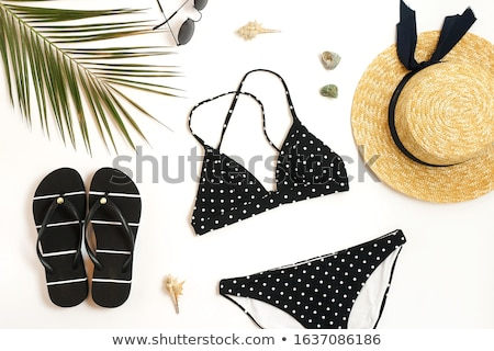 Photo stock: Colorful summer female fashion outfit. Black and white straw hat, flip flops
