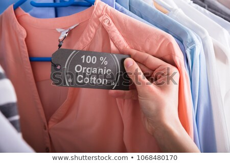 Woman Holding Label Showing 100 Percent Organic Cotton Stock photo © AndreyPopov