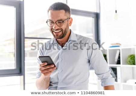 Obraz uśmiechnięty pracodawca facet biały Zdjęcia stock © deandrobot