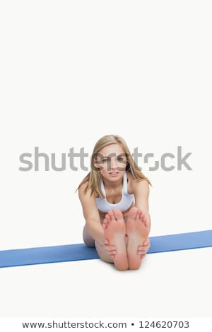 Woman performing stretching exercise Stock photo © Kzenon
