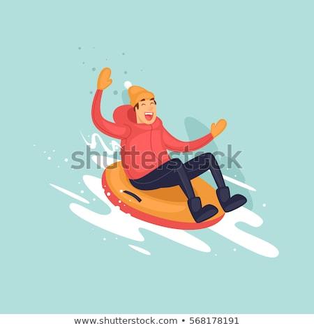 happy young man sliding down hill on snow tube Stock photo © dolgachov