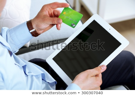 Hand holding green card in bright room Stock photo © wavebreak_media