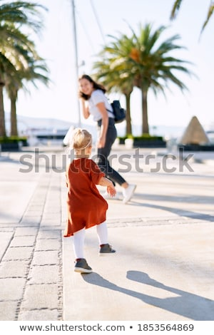 Beautiful happy mother with lher ittle daughter in knit sweater  Stock photo © dashapetrenko