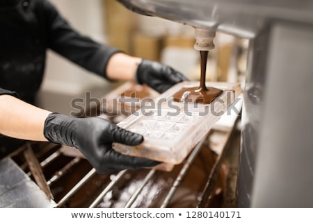 confectioner filling mold by cream at pastry shop Stock photo © dolgachov