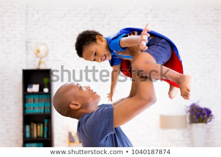 Portré boldog apa kicsi fiú otthon Stock fotó © dolgachov