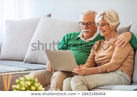 Vista lateral ativo casal de idosos relaxante sol Foto stock © wavebreak_media