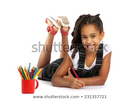 Side view of happy African American children lying on floor and using digital tablet while parents s Stock photo © wavebreak_media