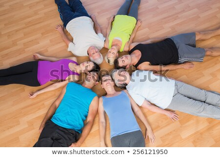 High angle view of senior people exercising with female trainer using dumbbells in fitness studio Stock photo © wavebreak_media