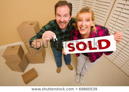 Animado mulher casa teclas vendido Foto stock © feverpitch