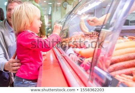 çocuk et karşı süpermarket bakıyor kadın Stok fotoğraf © Kzenon