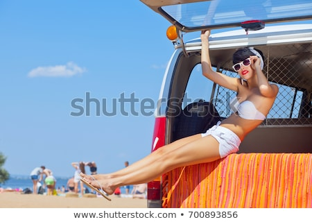 A retro girl with a beautiful red old car. Stock photo © Lopolo