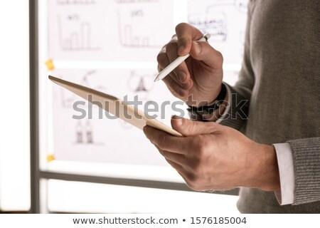 Eller erkek komisyoncu kalem işaret touchpad Stok fotoğraf © pressmaster