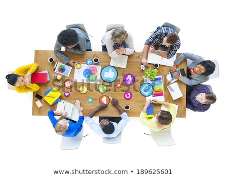 Group of contemporary creative designers gathered by table in studio Stock photo © pressmaster