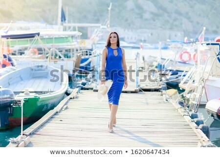 Volwassen vrouw vakantie houten boot pier Stockfoto © ElenaBatkova