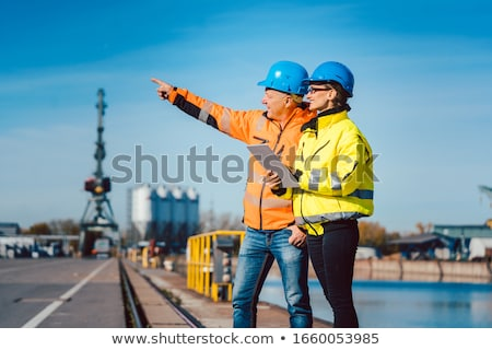 Workers in a commercial river port Stock photo © Kzenon