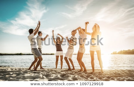 Beach fun summer vacation under the sun joyful happy bikini woman jumping of joy on Tahiti luxury tr Stock photo © Maridav