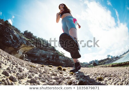 Exercise fitness athlete woman jogging on beach training cardio in summer vacation background. Blue  Stock photo © Maridav
