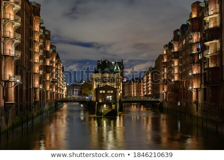 The historic Speicherstadt with the Wasserschloss Stock photo © elxeneize