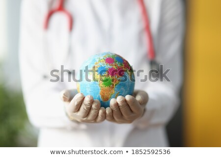 Lung doctor hand in protective glove holding stethoscope Stock photo © simazoran